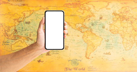 Man hand holding smartphone with world map on background