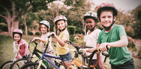 Smiling children posing with bikes