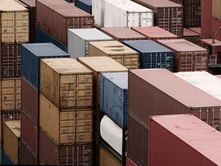 Shipping Containers Stacked At Busy Cargo Port