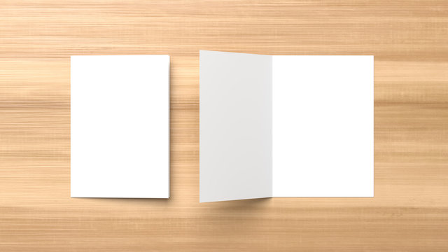 Realistic bi fold brochure or invitation mock up isolated on wooden background. 3D illustration.
