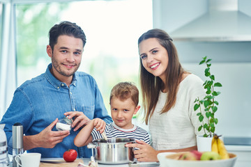 Young family spending time together in the kitchen