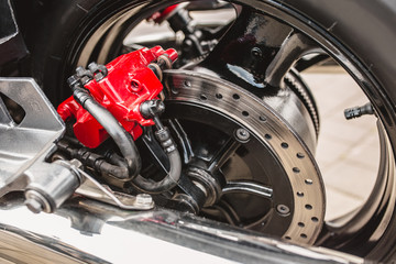 Red brake caliper on a motorcycle wheel - high-quality and reliable brake system