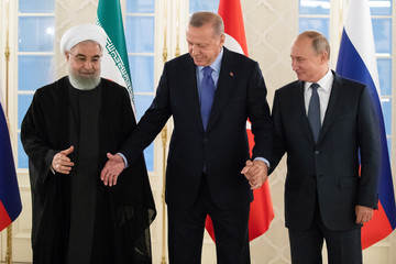 Presidents Hassan Rouhani of Iran, Tayyip Erdogan of Turkey and Vladimir Putin of Russia shake hands before their meeting in Ankara