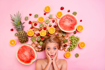 Close up top above high angle view photo beautiful she her lady lying down among different half slices fruits long volume hair afraid scared vegetables spoiled bad not fresh isolated pink background