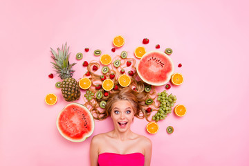 Close up top above high angle view photo beautiful she her lady lying down among different half slices fruits in long volume hair amazing wondered unexpected expression isolated pink background