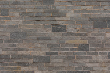 Gray granite wall with brick pattern for wallpaper.