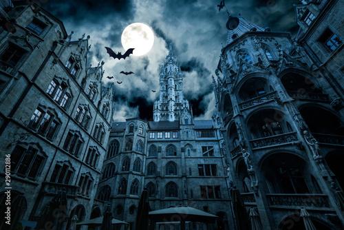 Scary dark scene with moon and bats. Fantasy horror for Halloween theme. Marienplatz at night, Munich, Germany.