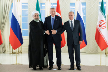 Presidents Hassan Rouhani of Iran, Tayyip Erdogan of Turkey and Vladimir Putin of Russia shake hands during their meeting in Ankara