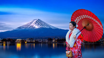 Wall Mural - Asian woman wearing japanese traditional kimono at Fuji mountain, Kawaguchiko lake in Japan.