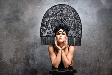 Beautiful woman in Russian kokoshnik hat. Retro fashion