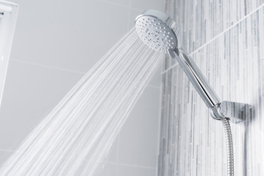 Bathroom shower head spraying water