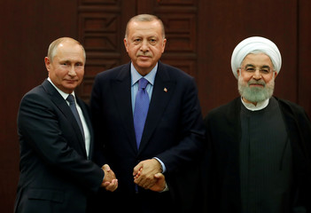 Presidents Putin of Russia, Erdogan of Turkey and Rouhani of Iran pose following a joint news conference in Ankara