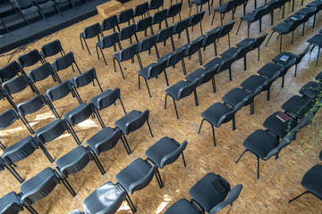Empty chairs in the assembly hall are arranged in rows, top view