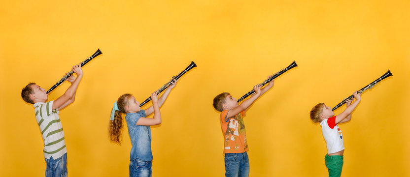 Four people, a musician, stand in a row and play clarinets, photos of children on a yellow background.