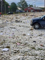 A car is seen on the site of an explosion in Farmington