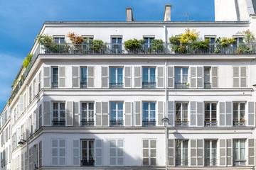 Paris, charming street and buildings, typical parisian facades in the Marais