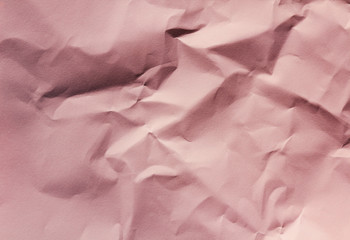 Crumpled pink paper texture background. Packaging process. Gift shop. Decorative wrapping.