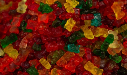 unhealthy food marmalade bears colorful candies textured background