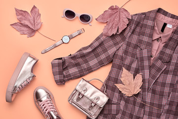 Fall fashion Clothes Accessories Outfit, Maple Leaf. Autumn creative minimal Flat lay. Trendy coral jacket, Stylish hipster sneakers gold shoes, handbag, Fashionable autumnal color, shopping concept Wall mural
