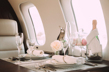 modern and comfortable interior of business jet aircraft with decor