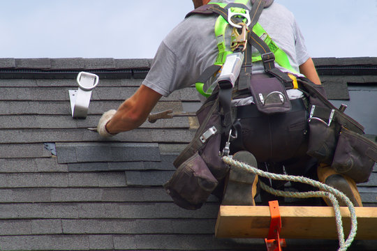 roof repair construction worker roofer man roofing security rope