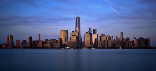 City skyline of One World Trade Center and Battery Park city esplanade at dusk, Manhattan, New York, United States