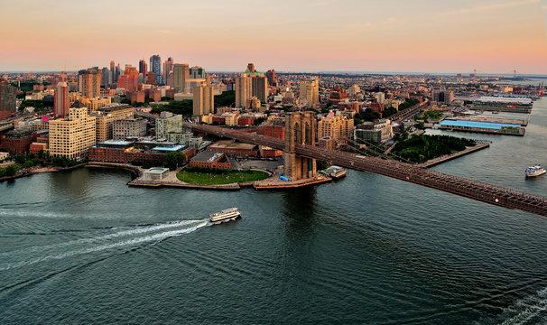 Aerial view of Brooklyn Bridge and Manhattan at sunset, New York, United States