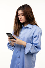 Beautiful Hispanic teen girl using using touch screen cell phone