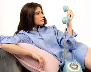 Beautiful Hispanic teen girl with vintage telephone