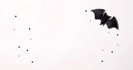 Halloween black paper bat - overhead view flat lay