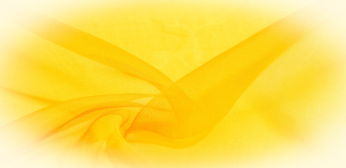 Texture of yellow silk fabric. It is also perfect for your design, clothes, posters. Be creative with beautiful project accents. This fabric is inspired by your inspiration.