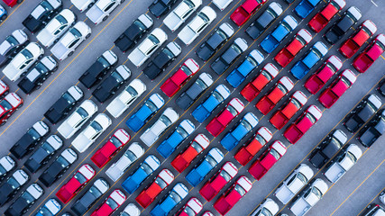 Aerial view car for sale stock lot row, Cars dealership inventory distribution automobile and automotive business.