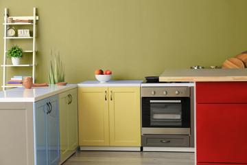 Interior of modern kitchen with stylish furniture