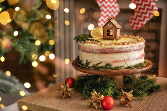 Sweet Christmas cake on table in room