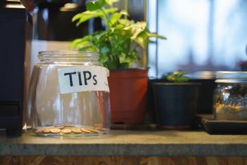 Glass tips jar in cafe Fototapete