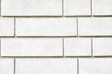 Background from a wall with white stone slabs