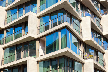 Detail of a modern apartment building with floor-to-ceiling windows seen in Berlin, Germany