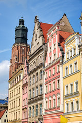 Multi colored houses with St. Elizabeth's Church in the back seen in Wroclaw, Poland