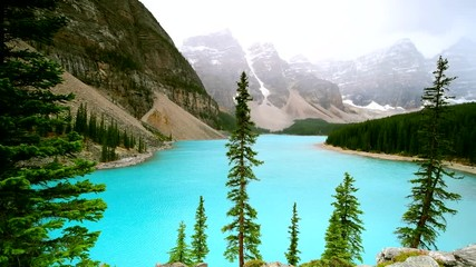 Wall Mural - Beautiful turquoise waters of Moraine lake in Banff National Park, Alberta, Canada