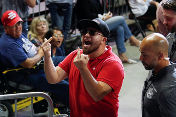 Members of the audience shout at an anti-Trump protestor as U.S. President Donald Trump delivers remarks during a Keep America Great rally at the Santa Ana Star Center in Rio Rancho