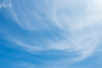 Bright blue sky with white soft motion clouds