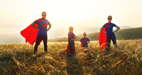 concept of super family, family of superheroes at sunset .