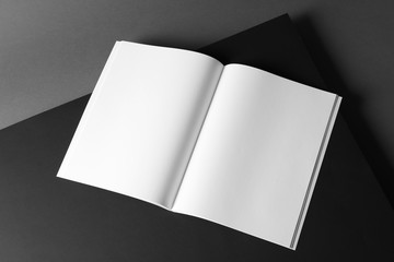 Empty book pages on dark background. Mockup for design Wall mural