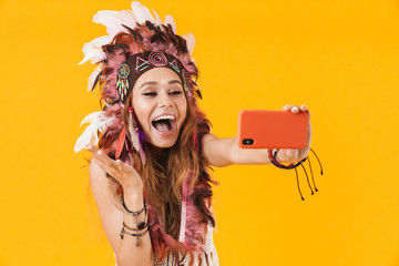 Poster Carnaval Indian woman in carnival suit take selfie by mobile phone.