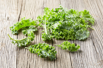 Kale leaves on wooden background