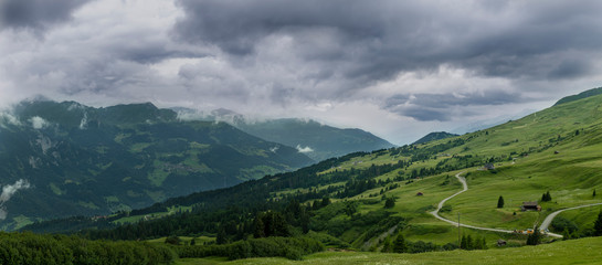 A landscape image of a beautiful mountain scenery with heavy clouds in the Swiss Alps.