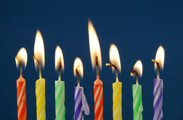 Eight birthday candles on blue background