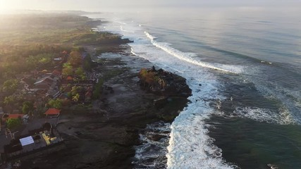 Wall Mural - Aerial view of Tanah lot temple at sunrise in Bali, Indonesia.