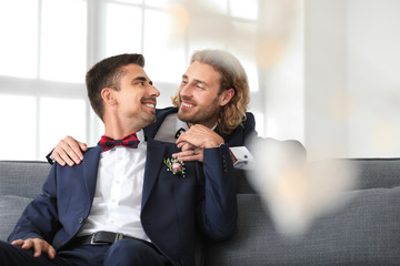 Happy gay couple on their wedding day at home