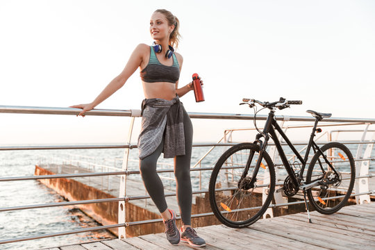 Beautiful young fitness woman cyclist wearing